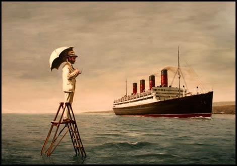 hombre con paraguas contemplando un buque